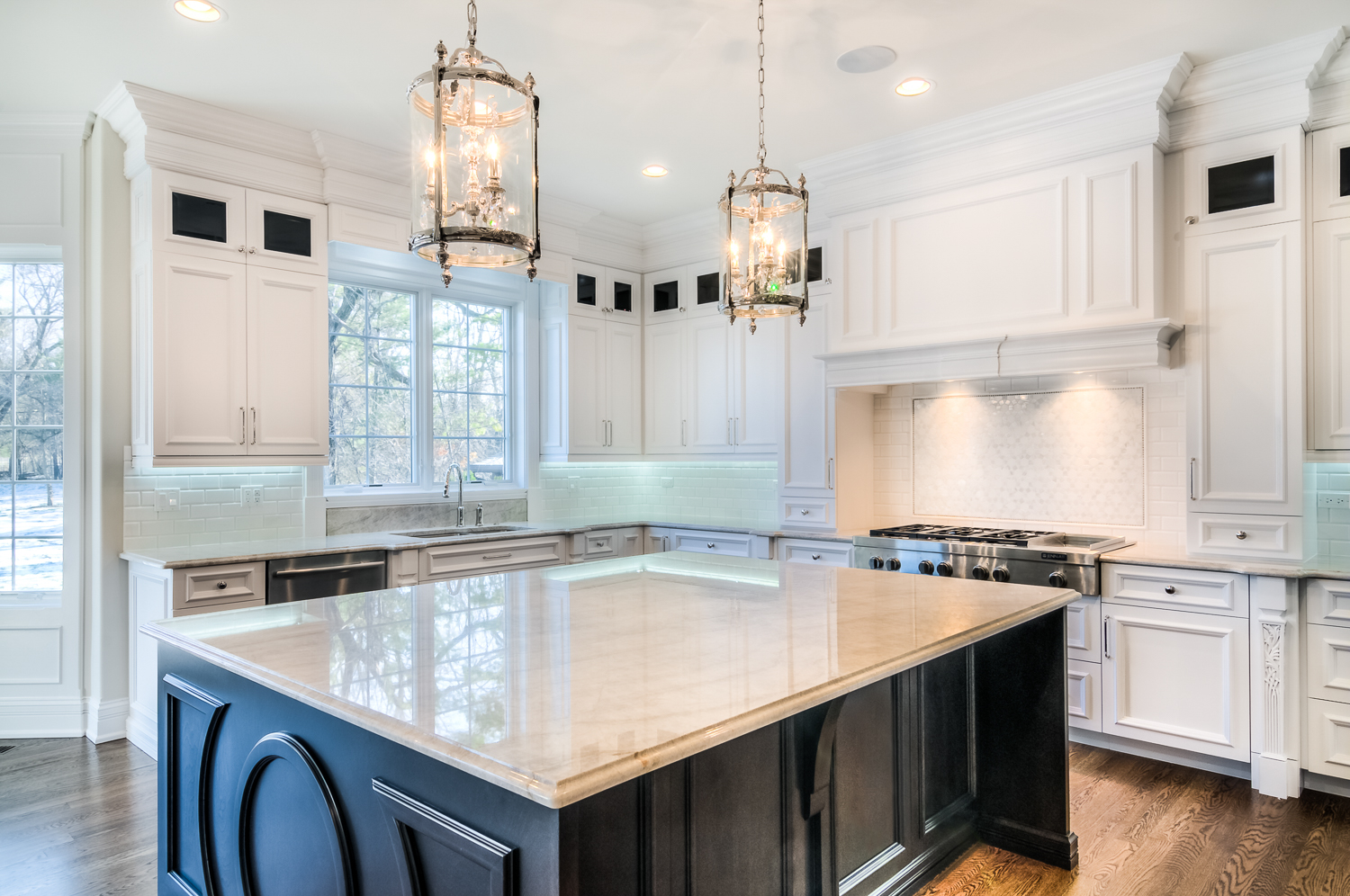 A modern kitchen featuring granite countertops from NEKA