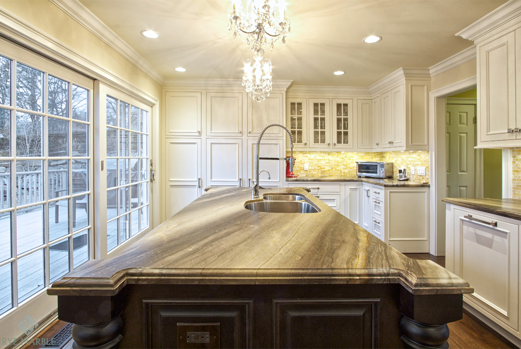 A kitchen with a traditional feel featuring granite countertops from NEKA